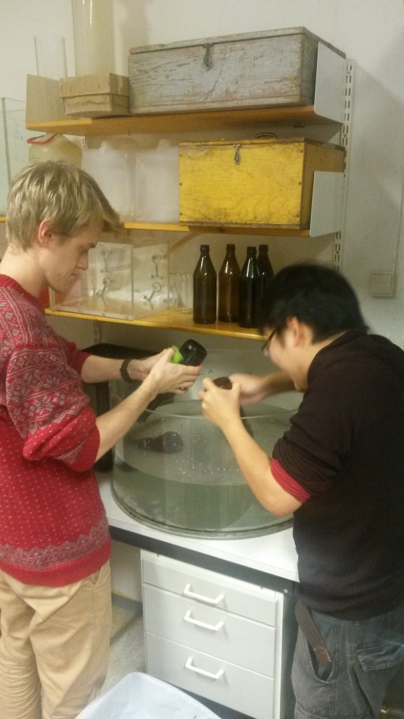 Håvard and Fumiaki cleaning bottles
